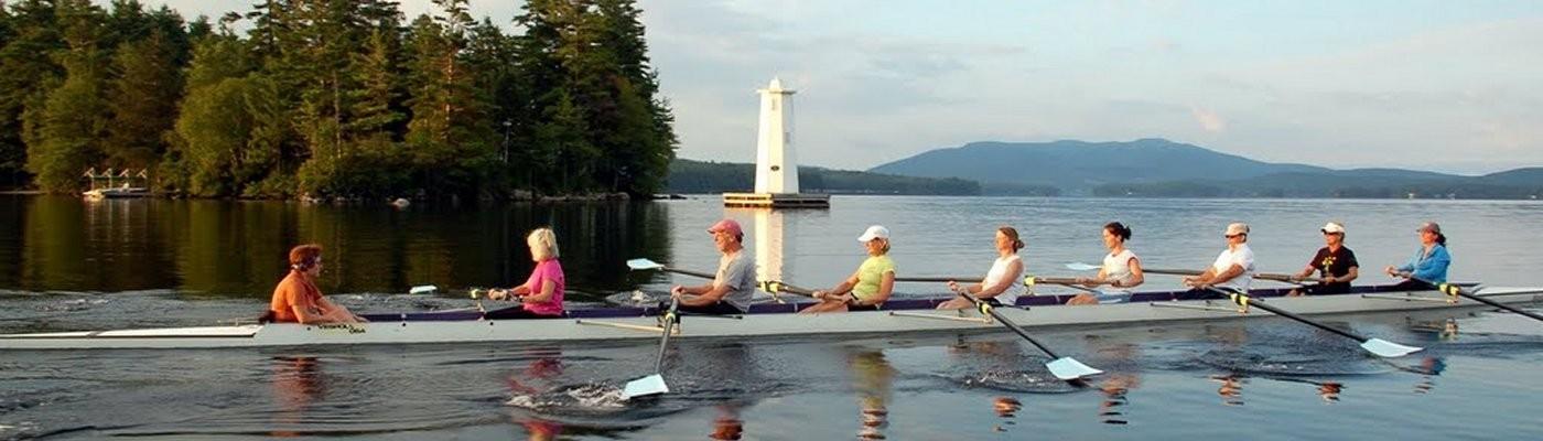 LSRC rowing past lighthouse